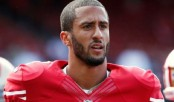 American Football player Kaepernick refuses to stand for anthem