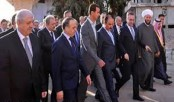 His Position Secure, Assad Smiles While Syria Burns