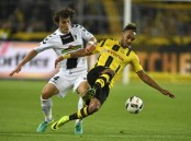 Free-scoring Dortmund beats Freiburg 3-1 as newcomers shine