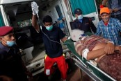 Overcrowded bus slips off mountain road in Nepal, killing 14
