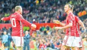 Totti sets up Roma rout, Zlatan delivers for United