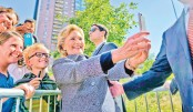 Hillary Clinton takes a selfie with supporters