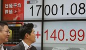 Asian stocks meander as Samsung plunges, oil falls back