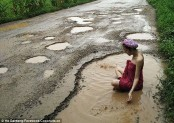 Thai model takes dip in the road in pothole protest