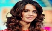 Mallika Sherawat back in Mumbai with French beau, meets filmmakers