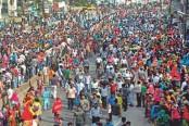 RMG workers block city road