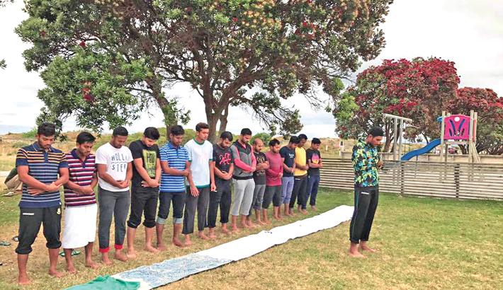Bangladesh cricketers captured during a prayer at Christchurch