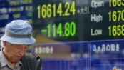 Asian stocks lower in light trading after Christmas