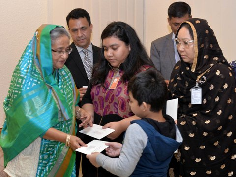 Prime Minister Sheikh Hasina distributes cheques to families of 4 slain policemen