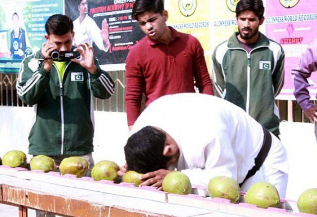 Pakistani man smashes 43 coconuts with his head in just 60 seconds (Video)
