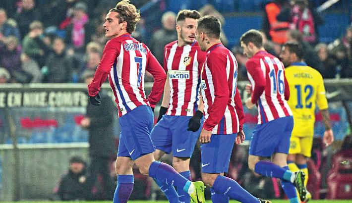 Atletico reach Copa del Rey quarters despite loss