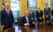 Trump signs abortion policy for aid to NGOs