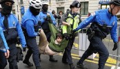 Six reporters among 230 people charged in anti-Trump protests in Washington
