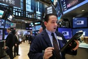 US stocks back in record range after solid jobs data