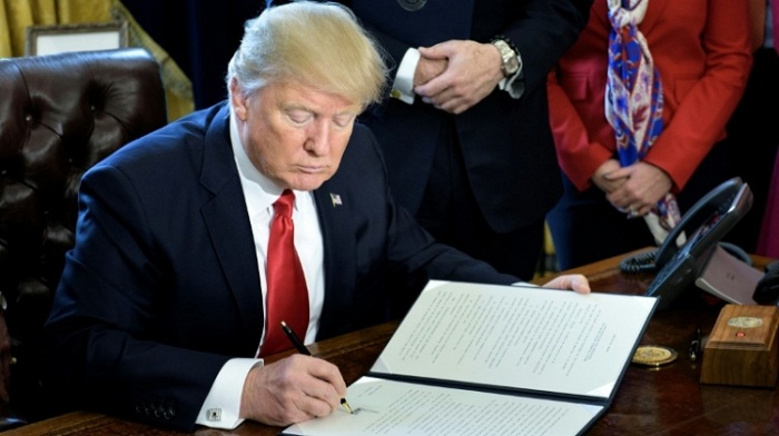 Trump appeals but travel ban block remains in place