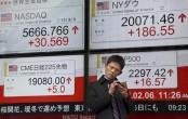 Asian shares mostly higher cheered by Wall Street rise