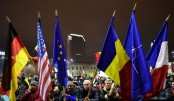 Romania scraps corruption decree, but protesters keep up pressure