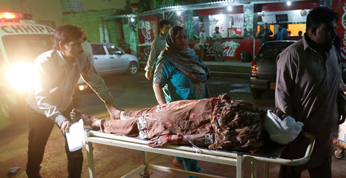 Islamic State-claimed bomb kills 70 at Pakistani shrine