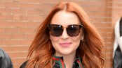 Lindsay Lohan asked to remove headscarf at Heathrow airport