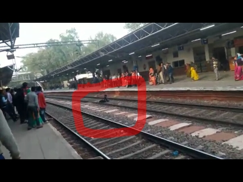 Woman falls on railway track, is unhurt after train runs over (Video)