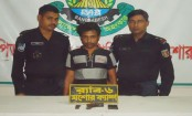 Terrorist held with arms at Benapole