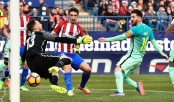 Messi haunts Atletico once more to send Barca top