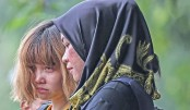 Tight security as two women charged with Kim murder in Malaysia