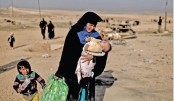 Hungry and afraid, Mosul  civilians flee
