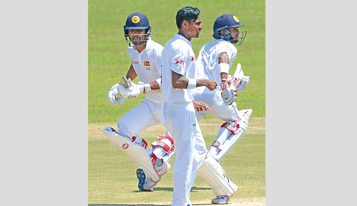 Lucky Mendis ton puts SL on top