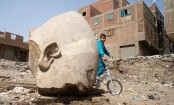Massive statue of Egyptian ruler discovered in Cairo slum