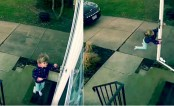 Girl gets almost blown away in front of her house (Video)