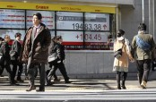 Asian shares mostly higher on cheer over US jobs report