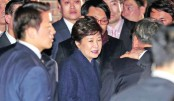 Ousted S Korean leader returns home, expresses defiance