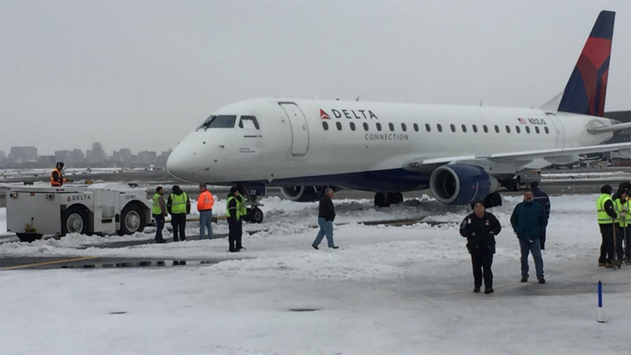 Plane that landed at NYC airport gets stuck in snowdrift