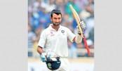 Pujara, Saha put India on top