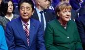 Merkel, Abe call for open markets