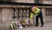 British MPs back at work but parliament remains a crime scene
