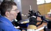 Quadriplegic man regains use of arm in medical first