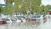 One dead as cyclone flooding overwhelms Australian towns