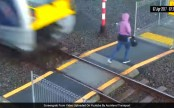 New Zealand woman cheats death, leaps from speeding train at last second (Video)