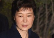 Former South Korean president charged in corruption probe