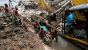 Death toll in Sri Lanka garbage mound collapse rises to 26