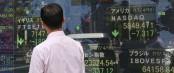 Asian stocks slip on UK surprise election, weak earnings