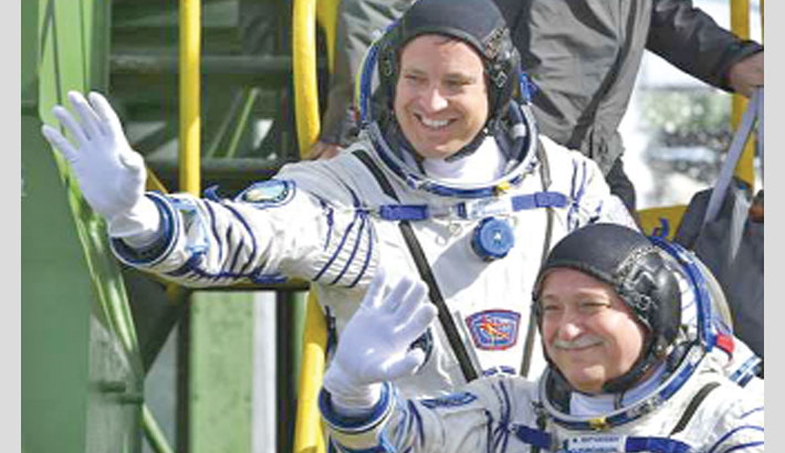 Russian, American two-man crew blasts off to ISS