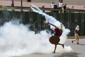 At least 12 people killed overnight in Venezuela violence, officials say
