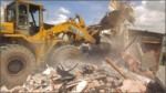 Rajuk pulls down illegal structures at Dhanmondi