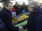Macron hunts for French rural votes, Le Pen cheers new ally