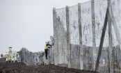 Hungary completes second fence to keep out migrants