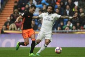 Real Madrid score late to beat Valencia 2-1 and regain La Liga lead