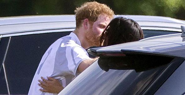 Prince Harry and Meghan Markle spotted kissing